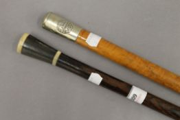 A horn handled walking stick and a Regimental walking stick. The former 90 cm high.