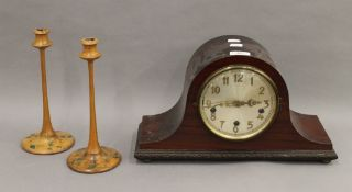 A pair of penwork candlesticks and a mantle clock. The former each 25.5 cm high.
