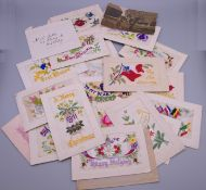 A collection of WWI silk postcards.
