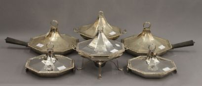 A set of six silver serving/warming dishes, together with two silver plated stands and burners.
