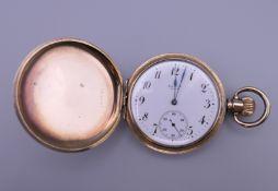An Elgin Full Hunter in an original Dennison gold plated case pocket watch. 5 cm diameter.