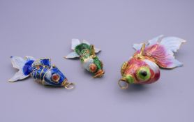 Three cloisonne fish. The largest 8.5 cm long.