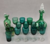 A quantity of various green glassware.