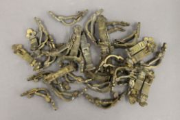A quantity of Victorian brass stair rod clips.