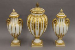 Three 19th century gilt decorated Sevres porcelain vases. The largest 48 cm high.