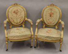 A pair of 19th century tapestry covered gilt armchairs. Each 65 cm wide.