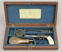 A cased Allen and Thurber pistol. The case 22.5 cm wide.