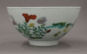 A Chinese porcelain bowl decorated with chickens. 12.5 cm diameter.