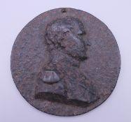 An iron Napoleon plaque. 10 cm wide.