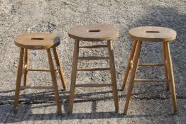 Three elm seated stools.