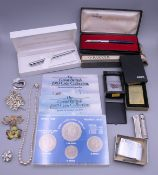 A quantity of costume jewellery, lighters,
