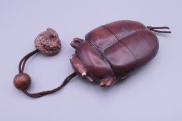 A beetle formed wooden inro. 6 cm wide.