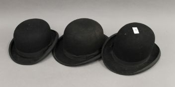 Three vintage bowler hats.