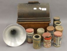A Thomas A Edison oak cased phonograph with horn; together with a selection of phonograph rolls. 32.