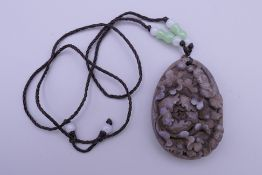 A carved pendant. 5.5 cm high.