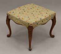 A Victorian tapestry upholstered walnut stool. 52.5 cm wide.