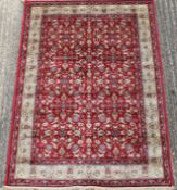 A red ground full pile Kashmir all over floral rug. 170 x 120 cm.