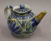 A Doulton Lambeth stoneware teapot. 11 cm high.