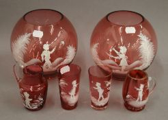 A quantity of Mary Gregory type cranberry glass.