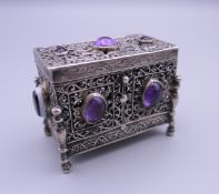 A Continental 800 silver box set with amethyst and agate cabochons. 5.5 cm high.