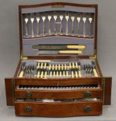 A canteen of silver plated cutlery by Liberty & Co. 47.5 cm wide.