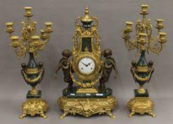 An ornate clock garniture. The clock 61 cm high.