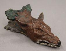 A bronze fox mask letter clip. 14.5 cm long.