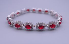 A 925 silver and rhodium plated synthetic ruby and diamond bracelet. 17.5 cm long.