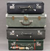 Four vintage suitcases, including a tin example. 66.5 cm wide.