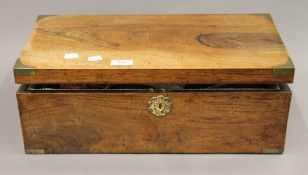 A 19th century rosewood writing slope (re-fitted as a sewing box). 48 cm wide.