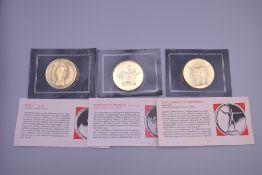 Three Franklin mint coins