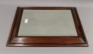 A mahogany wall glass. 61 cm wide.