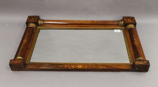 A 19th century inlaid rosewood over mantle mirror. 72 cm wide.
