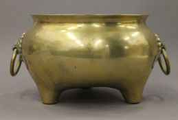 A Chinese bronze twin handled censer. 22 cm wide.