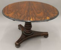 A 19th century rosewood tilt top breakfast table. 120 cm diameter.