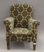 An early 20th century child's upholstered arm chair. 56 cm wide.