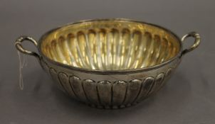 A silver twin handled bowl. 18.5 cm diameter including handles. 8.8 troy ounces.