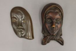 An Art Deco porcelain wall mask and another. The former 23 cm high.