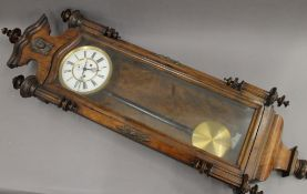 A walnut cased Vienna regulator wall clock. 135 cm high.