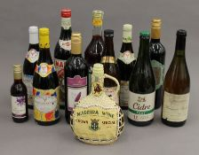 A quantity of various bottles of wine.