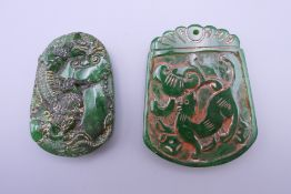 Two jade pendants. The largest 5.5 cm high.