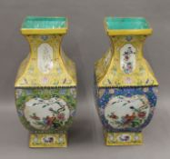 A pair of Chinese yellow and blue ground porcelain vases. 47 cm high.