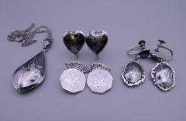 A Siam sterling silver niello pendant on a silver chain,