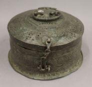 An Indian bronze lidded food box. 28.5 cm diameter.
