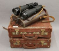 A cased pair of binoculars and two small cases.