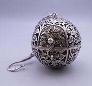 A Chinese silver travelling ball censer. 6 cm wide.
