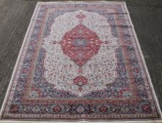 An ivory ground full pile Kashmir traditional medallion rug. 330 x 240 cm.