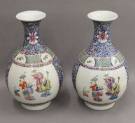 A pair of Chinese ovoid porcelain vases decorated with figures. 38 cm high.