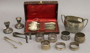 A quantity of various silver items, including napkin rings, candlesticks, etc. 11.