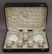 A cased Aynsley silver mounted coffee set. The case 38 cm wide.